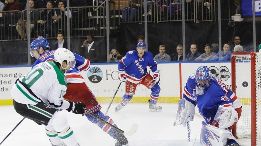 Dallas Stars' Patrick Sharp (10) shoots against New York Rangers goalie Henrik Lundqvist (30), of Sweden, for a goal during the first period of an NHL hockey game Tuesday, Jan. 17, 2017, in New York. (AP Photo/Frank Franklin II)