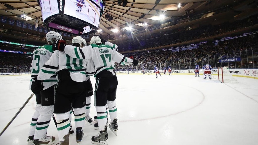 The Dallas Stars celebrate a goal by Patrick Sharp during the first period of an NHL hockey game against the New York Rangers on Tuesday, Jan. 17, 2017, in New York. (AP Photo/Frank Franklin II)