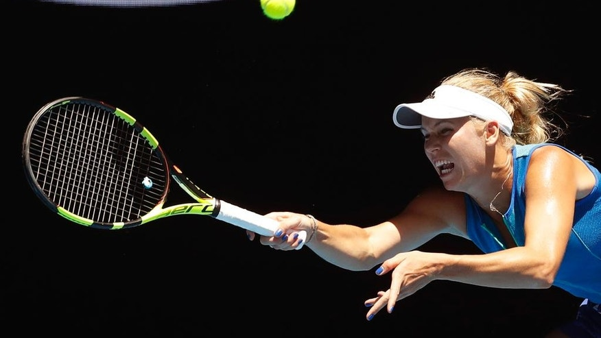 Denmark's Caroline Wozniacki makes a forehand return to Croatia's Donna Vekic during their second round match at the Australian Open tennis championships in Melbourne, Australia, Thursday, Jan. 19, 2017. (AP Photo/Kin Cheung)