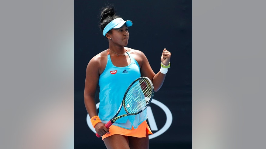 Japan's Naomi Osaka celebrates after defeating Thailand's Luksika Kumkhum during their first round match at the Australian Open tennis championships in Melbourne, Australia, Tuesday, Jan. 17, 2017. (AP Photo/Kin Cheung)