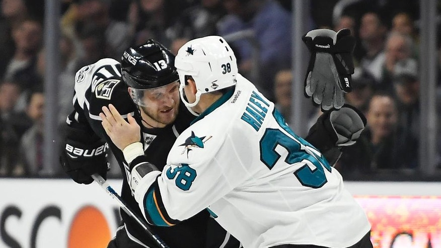 Los Angeles Kings left wing Kyle Clifford, left, and San Jose Sharks center Micheal Haley start to fight during the second period of an NHL hockey game, Wednesday, Jan. 18, 2017, in Los Angeles. (AP Photo/Mark J. Terrill)