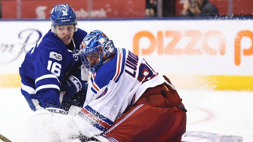 Toronto Maple Leafs center Mitchell Marner (16) is stopped by New York Rangers goalie Henrik Lundqvist (30) during the second period of an NHL hockey game, Thursday, Jan. 19, 2017 in Toronto. (Frank Gunn/The Canadian Press via AP)