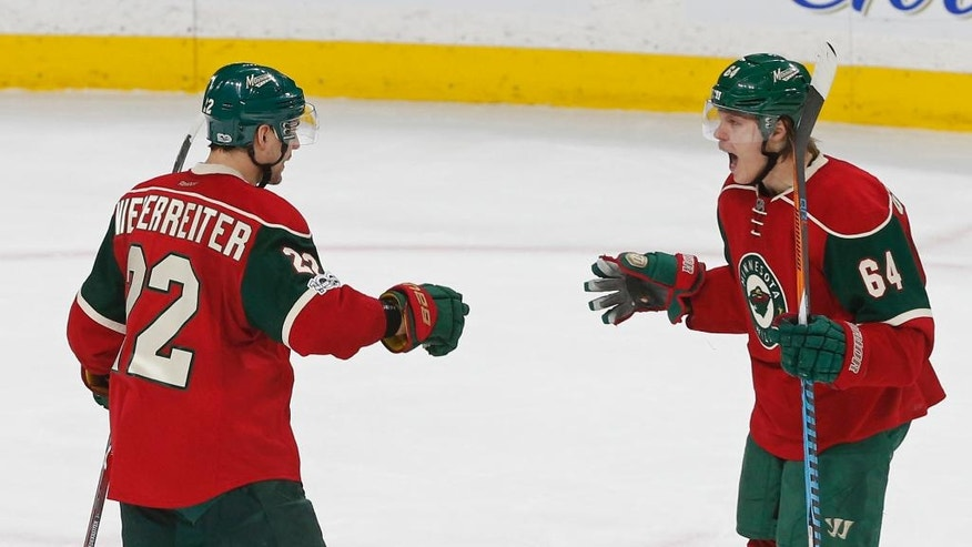 Minnesota Wild's Mikael Granlund, right, of Finland, celebrates the go-ahead goal by Nino Niederreiter, left, of Switzerland off Arizona Coyotes goalie Louis Domingue during the third period of an NHL hockey game Thursday, Jan. 19, 2017, in St. Paul, Minn. The Wild won 4-3. Niedereitter scored two goals in the game. (AP Photo/Jim Mone)