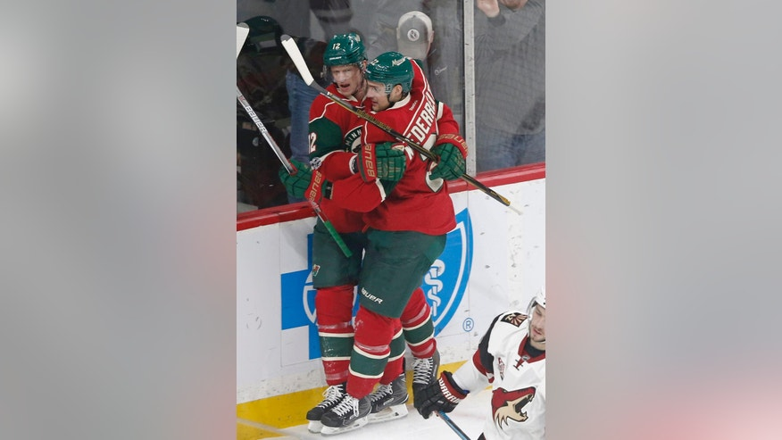 Minnesota Wild's Eric Staal, left, and Nino Niederreiter of Switzerland celebrate Staal's goal off Arizona Coyotes goalie Louis Domingue during the first period of an NHL hockey game Thursday, Jan. 19, 2017, in St. Paul, Minn. Niederreiter also scored during the first period on a power play. (AP Photo/Jim Mone)