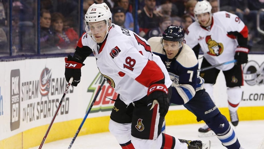 Ottawa Senators' Ryan Dzingel, left, looks to pass as Columbus Blue Jackets' Jack Johnson defends during the third period of an NHL hockey game Thursday, Jan. 19, 2017, in Columbus, Ohio. The Senators beat the Blue Jackets 2-0. (AP Photo/Jay LaPrete)
