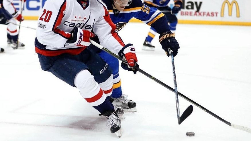 Washington Capitals' Lars Eller, of Denmark, and St. Louis Blues' Colton Parayko, right, chase the puck during the first period of an NHL hockey game Thursday, Jan. 19, 2017, in St. Louis. (AP Photo/Jeff Roberson)