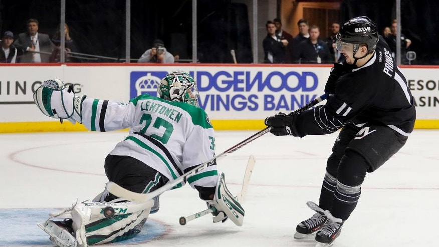 Dallas Stars goalie Kari Lehtonen (32) deflects a shot by New York Islanders center Shane Prince (11) during the second period of an NHL hockey game, Thursday, Jan. 19, 2017, in New York. (AP Photo/Julie Jacobson)