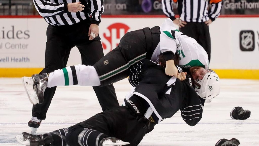 Dallas Stars center Radek Faksa, top, fights with New York Islanders defenseman Thomas Hickey (14) during the second period of an NHL hockey game, Thursday, Jan. 19, 2017, in New York. (AP Photo/Julie Jacobson)