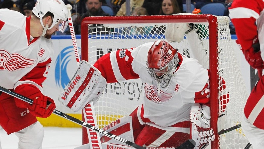 Detroit Red Wings goalie Petr Mrazek (34) makes a pad save during the first period of the team's NHL hockey game against the Buffalo Sabres, Friday, Jan. 20, 2017, in Buffalo, N.Y. (AP Photo/Jeffrey T. Barnes)