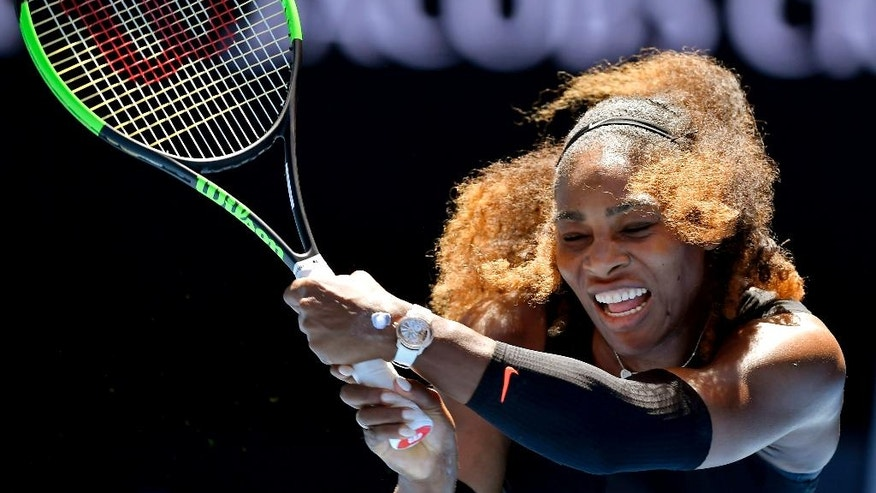 United States' Serena Williams hits a backhand return to compatriot Nicole Gibbs during their third round match at the Australian Open tennis championships in Melbourne, Australia, Saturday, Jan. 21, 2017. (AP Photo/Andy Brownbill)