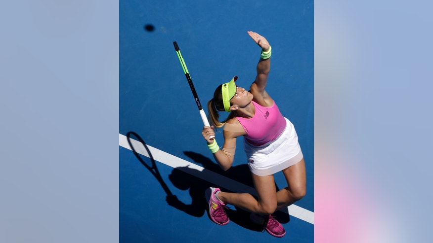 United States' Nicole Gibbs serves to compatriot Serena Williams during their third round match at the Australian Open tennis championships in Melbourne, Australia, Saturday, Jan. 21, 2017. (AP Photo/Dita Alangkara)