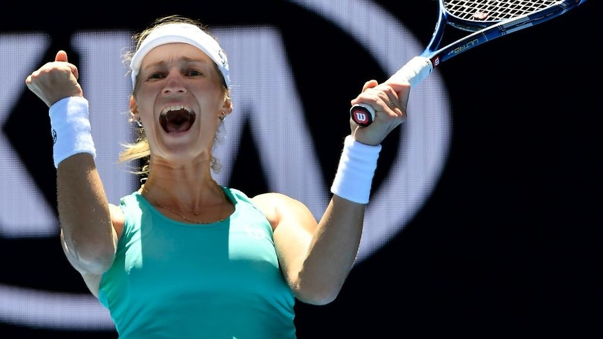 Russia's Ekaterina Makarova celebrates after defeating Slovakia's Dominika Cibulkova in their third round match at the Australian Open tennis championships in Melbourne, Australia, Saturday, Jan. 21, 2017. (AP Photo/Andy Brownbill)