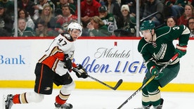 Minnesota Wild's Charlie Coyle controls the pucks against Anaheim Ducks' Hampus Lindholm in the second period of an NHL hockey game Saturday, Jan. 21, 2017, in St. Paul, Minn. (AP Photo/Stacy Bengs)