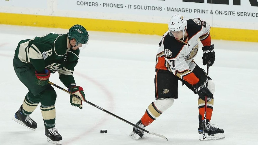 Anaheim Ducks Rickard Rakell's stick breaks while trying to control the puck against Minnesota Wild Eric Staal in the first period of an NHL hockey game Saturday, Jan. 21, 2017, in St. Paul, Minn. (AP Photo/Stacy Bengs)