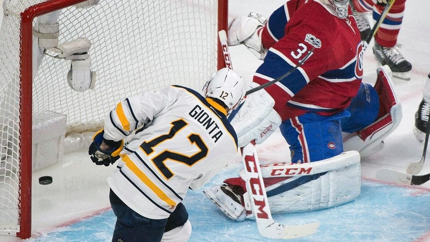 Buffalo Sabres' Brian Gionta (12) scores on Montreal Canadiens goaltender Carey Price during second-period NHL hockey game action in Montreal, Saturday, Jan. 21, 2017. (Graham Hughes/The Canadian Press via AP)