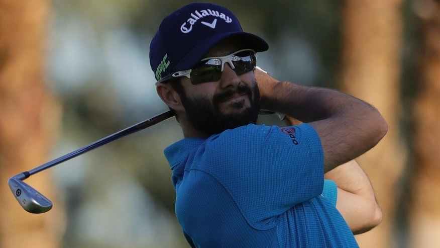 Adam Hadwin hits his tee shot on the 18th hole on his way to shooting a 59 and take the third round lead in the CareerBuilder Challenge golf tournament at La Quinta Country Club Saturday, Jan. 21, 2017, in La Quinta, Calif. (AP Photo/Chris Carlson)