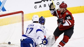 Arizona Coyotes right wing Christian Fischer (36) scores in his first NHL hockey game as the gets the puck past Tampa Bay Lightning defenseman Victor Hedman (77) and goalie Ben Bishop during the second period Saturday, Jan. 21, 2017, in Glendale, Ariz. (AP Photo/Ross D. Franklin)