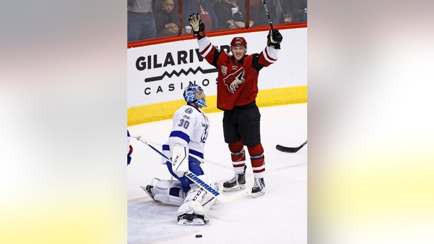 Arizona Coyotes right wing Christian Fischer, right, celebrates a goal in his first NHL hockey game, against Tampa Bay Lightning goalie Ben Bishop (30) during the second period Saturday, Jan. 21, 2017, in Glendale, Ariz. (AP Photo/Ross D. Franklin)