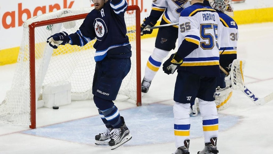 Winnipeg Jets' Mark Scheifele (55) celebrates his goal on St. Louis Blues goaltender Pheonix Copley (30) as Alex Pietrangelo (27) and Colton Parayko (55) defend the third period of an NHL hockey game in Winnipeg, Manitoba, Saturday, Jan. 21, 2017. (John Woods/The Canadian Press via AP)