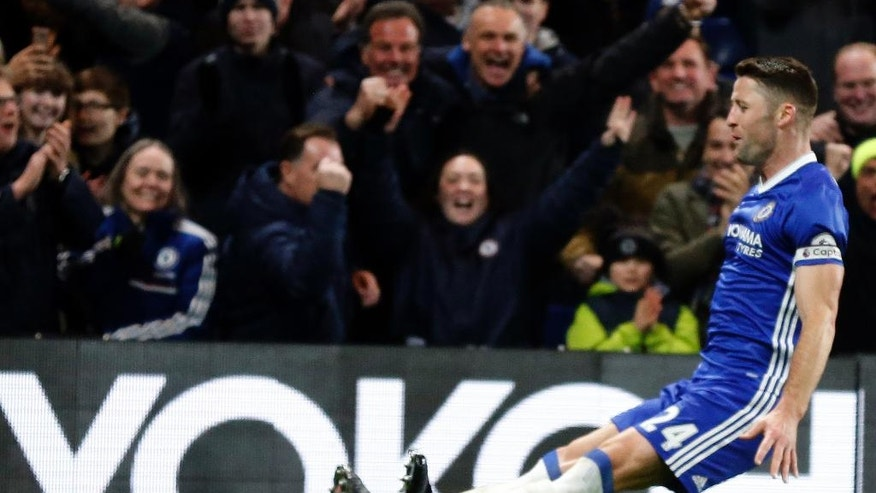 Chelsea's Gary Cahill celebrates after scoring during the English Premier League soccer match between Chelsea and Hull City at Stamford Bridge stadium in London, Sunday, Jan. 22, 2017. (AP Photo/Frank Augstein)