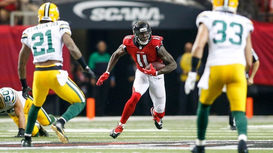 Oct 30, 2016; Atlanta, GA, USA; Atlanta Falcons wide receiver Julio Jones (11) runs after a catch against the Green Bay Packers in the first quarter at the Georgia Dome. Mandatory Credit: Brett Davis-USA TODAY Sports