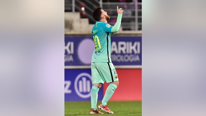 FC Barcelona's Lionel Messi celebrates after scoring against Eibar during the Spanish La Liga soccer match between FC Barcelona and Eibar, at Ipurua stadium in Eibar, northern Spain, Sunday, Jan. 22, 2017. (AP Photo/Alvaro Barrientos)