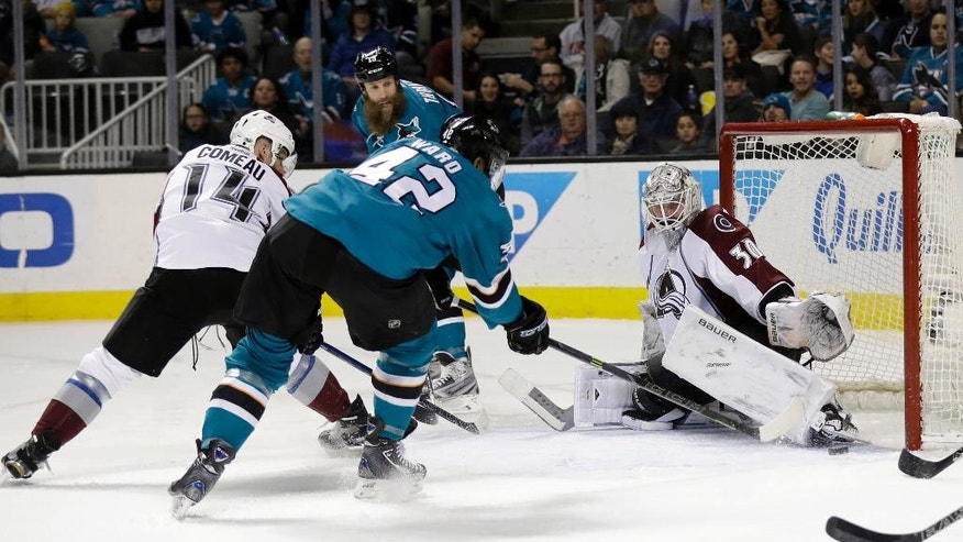 San Jose Sharks' Joel Ward (42) scores past Colorado Avalanche goalie Spencer Martin, right, during the first period of an NHL hockey game Saturday, Jan. 21, 2017, in San Jose, Calif. (AP Photo/Marcio Jose Sanchez)