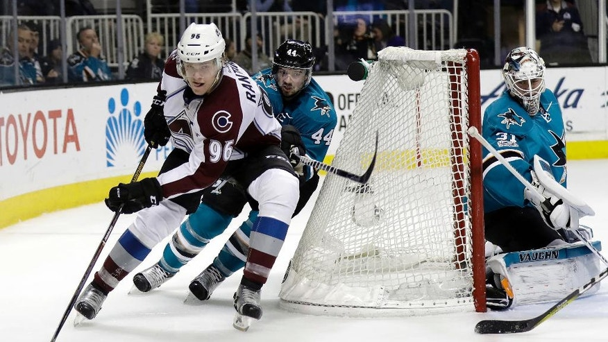 Colorado Avalanche's Mikko Rantanen (96) is chased by San Jose Sharks' Marc-Edouard Vlasic, center, during the second period of an NHL hockey game Saturday, Jan. 21, 2017, in San Jose, Calif. (AP Photo/Marcio Jose Sanchez)
