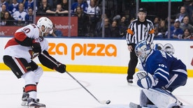 Ottawa Senators left wing Tom Pyatt, left, scores the game winning goal on Toronto Maple Leafs goalie Frederik Andersen in a shootout during an NHL hockey game, in Toronto on Saturday, Jan. 21, 2017. (Chris Young/The Canadian Press via AP)