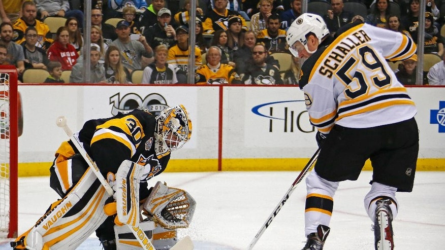 Boston Bruins' Tim Schaller (59) tries to shoot in front of Pittsburgh Penguins goalie Matt Murray (30) in the second period of an NHL hockey game in Pittsburgh, Sunday, Jan. 22, 2017. (AP Photo/Gene J. Puskar)