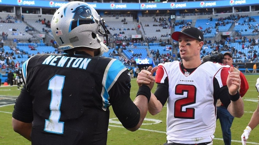 Dec 24, 2016; Charlotte, NC, USA; Carolina Panthers quarterback Cam Newton (1) with Atlanta Falcons quarterback Matt Ryan (2) after the game. The Falcons defeated the Panthers 33-16 at Bank of America Stadium. Mandatory Credit: Bob Donnan-USA TODAY Sports
