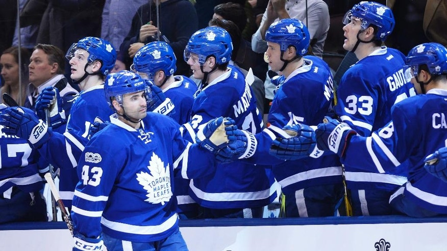 Toronto Maple Leafs centre Nazem Kadri (43) celebrates his goal against the Calgary Flames during third period NHL hockey action in Toronto on Monday, Jan. 23, 2017. (Nathan Denette/The Canadian Press via AP)