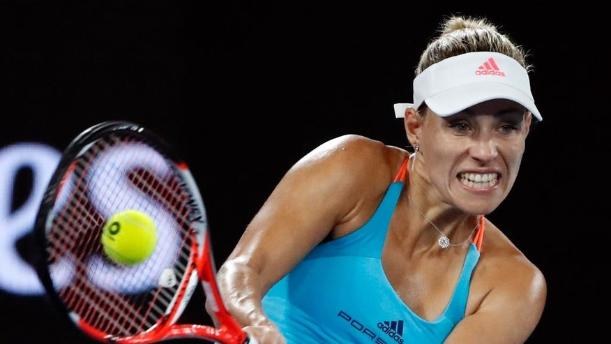 Germany's Angelique Kerber makes a backhand return to United States' Coco Vandeweghe during their fourth round match at the Australian Open tennis championships in Melbourne, Australia, Sunday, Jan. 22, 2017. (AP Photo/Dita Alangkara)