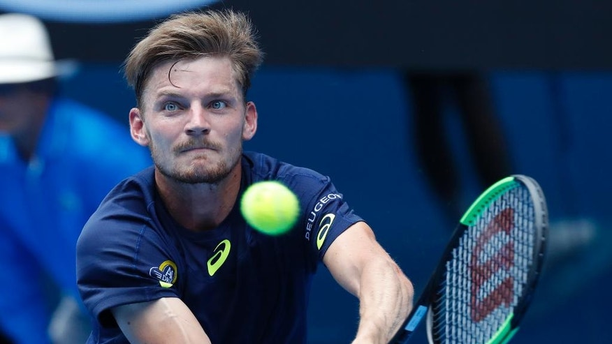 Belgium's David Goffin plays a backhand to Austria's Dominic Thiem during their fourth round match at the Australian Open tennis championships in Melbourne, Australia, Monday, Jan. 23, 2017. (AP Photo/Kin Cheung)