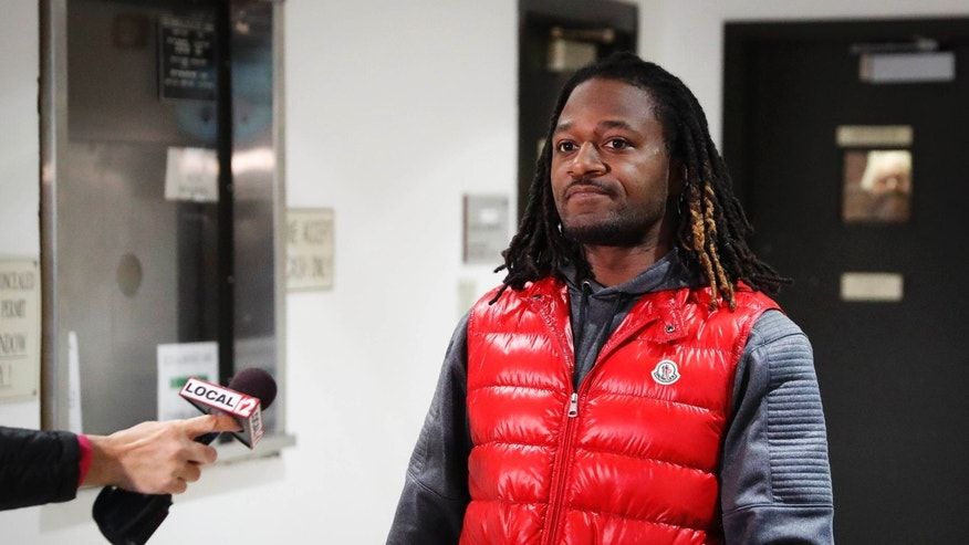 "Bengals cornerback Adam ""Pacman"" Jones prepares to speak with reporters as he is released from the Hamilton County Justice Center after be charged with felony harassment with a bodily substance, Wednesday, Jan. 4, 2017, in Cincinnati."