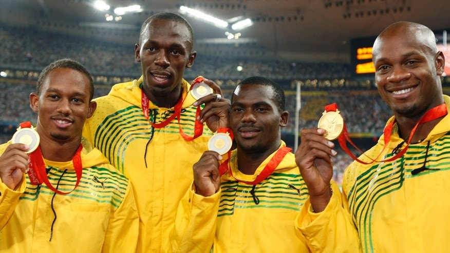 Gold medalists (L - R) Nesta Carter, Michael Frater, Usain Bolt, Asafa Powell of Jamaica pose during the medal ceremony for the men's 4 x 100m relay final of the athletics competition in the National Stadium at the Beijing 2008 Olympic Games August 23, 2008. REUTERS/Mike Blake (CHINA)  - RTR21LZC