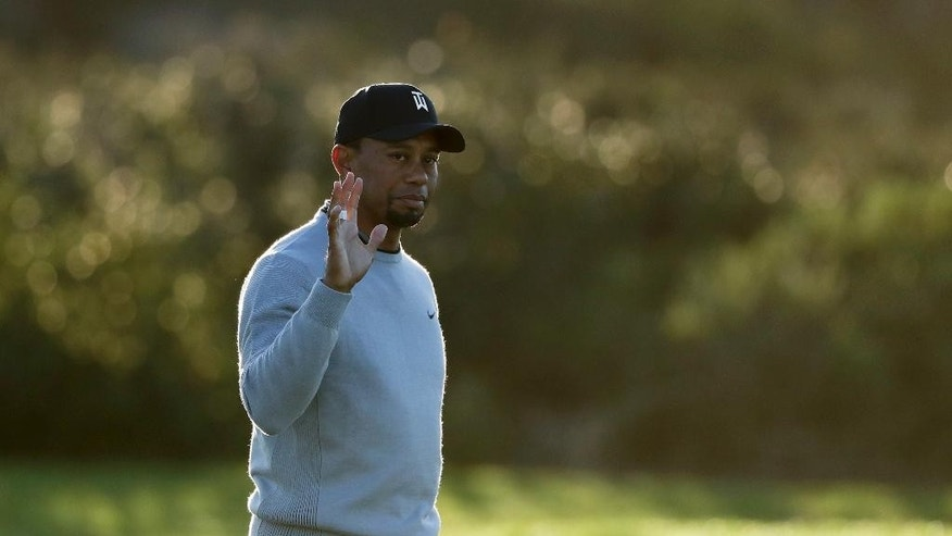 Tiger Woods reacts to the crowd on the third hole of the north course during the Pro-Am event of the Farmers Insurance Open golf tournament Wednesday, Jan. 25, 2017, in San Diego. (AP Photo/Gregory Bull)