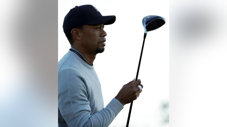 Tiger Woods holds his TaylorMade driver as he watches his tee shot on the fifth hole of the north course during the Pro-Am event of the Farmers Insurance Open golf tournament Wednesday, Jan. 25, 2017, in San Diego. Tiger Woods has added another equipment endorsement deal by signing with TaylorMade on Wednesday to play everything except the golf ball and the putter. Woods was open to shop around when Nike decided last year to get out of the hard equipment business. (AP Photo/Gregory Bull)