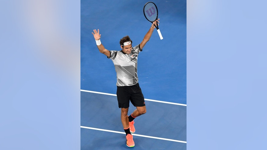 Switzerland's Roger Federer celebrates after defeating compatriot Stan Wawrinka during their semifinal at the Australian Open tennis championships in Melbourne, Australia, Thursday, Jan. 26, 2017. (AP Photo/Andy Brownbill)