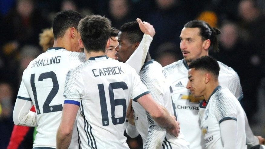 Manchester United's Paul Pogba, centrer, celebrates with team mates after scoring during the English League Cup, Semi Final Second Leg soccer match between Hull City and Manchester United at KCOM stadium in Hull, England, Thursday Jan. 26, 2017. (AP Photo/Rui Vieira)