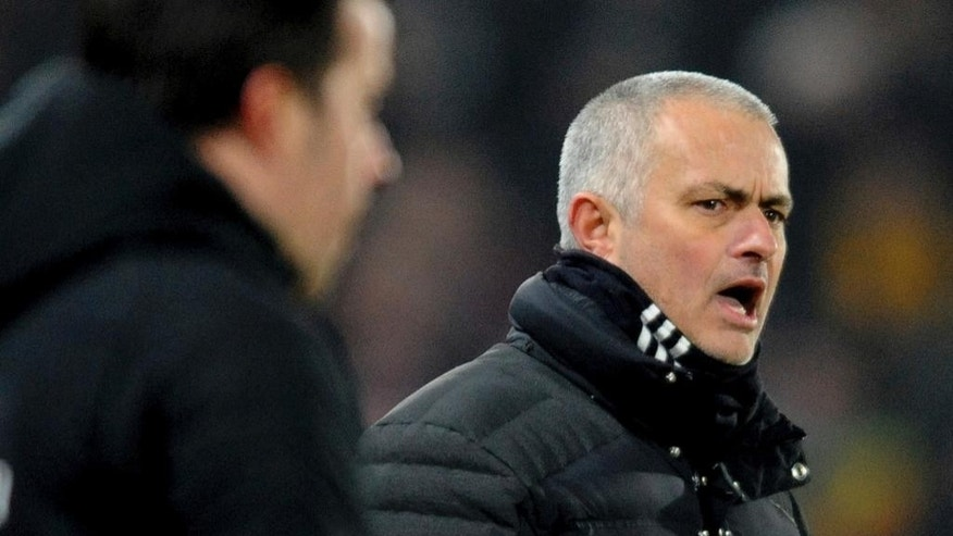 Manchester United manager Jose Mourinho, right, reacts during the English League Cup, Semi Final Second Leg soccer match between Hull City and Manchester United at KCOM stadium in Hull, England, Thursday Jan. 26, 2017. (AP Photo/Rui Vieira)