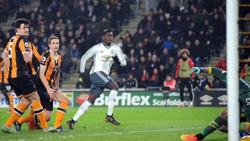 Manchester United's Paul Pogba, centre, scores during the English League Cup, Semi Final Second Leg soccer match between Hull City and Manchester United at KCOM stadium in Hull, England, Thursday Jan. 26, 2017. (AP Photo/Rui Vieira)