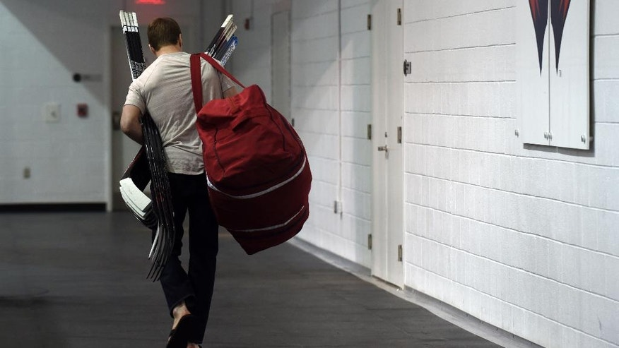 FILE - In this May 15, 2015, file photo, Washington Capitals defenseman Matt Niskanen leave the Kettler Capitals Iceplex in Arlington, Va. The team cleaned out their lockers after being eliminated in the Stanley Cup playoffs. A five-day bye week for each team is a new wrinkle added to the NHL this season so players can get a breather during the second half of a grueling, 82-game grind. Players are widely in favor of the extra time off even though it compresses the schedule for the rest of the year, but it isn't as popular among coaches and general managers. (AP Photo/Susan Walsh, File)
