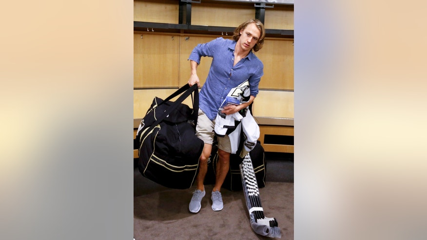 FILE - In this June 16, 2016, file photo, Pittsburgh Penguins' Carl Hagelin carries his equipment bag out of their locker room after the end of the NHL hockey season in Pittsburgh. A five-day bye week for each team is a new wrinkle added to the NHL this season so players can get a breather during the second half of a grueling, 82-game grind. No matter the timing, bye weeks make for a difficult adjustment back to game shape. (AP Photo/Keith Srakocic, File)