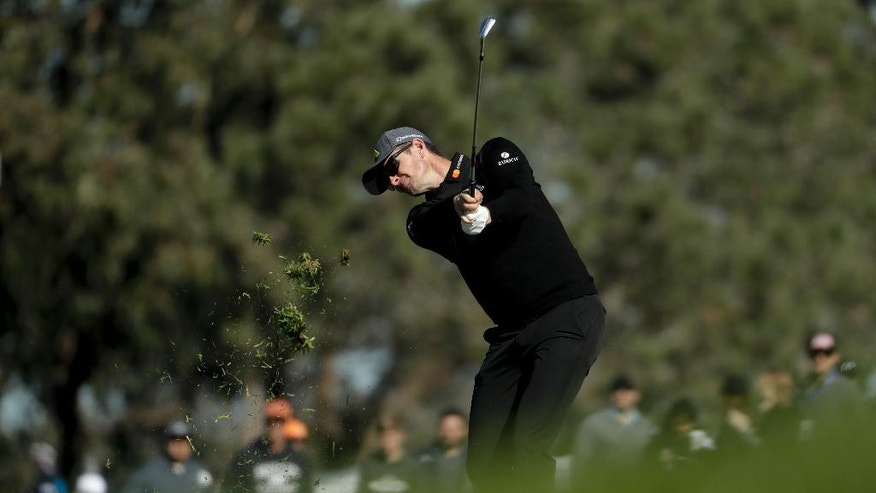 Justin Rose hits to the second hole during the second round of the Farmers Insurance Open golf tournament on the South Course at the Torrey Pines Golf Course Friday, Jan. 27, 2017, in San Diego. (AP Photo/Chris Carlson)