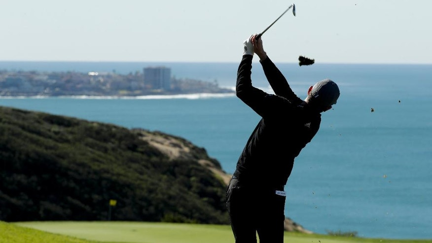 Justin Rose tees off on the third hole during the second round of the Farmers Insurance Open golf tournament on the South Course at the Torrey Pines Golf Course Friday, Jan. 27, 2017, in San Diego. (AP Photo/Chris Carlson)