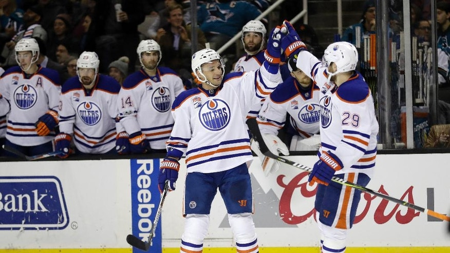 Edmonton Oilers' Andrej Sekera, front left, celebrates his goal with teammate Leon Draisaitl (29) during the second period of an NHL hockey game against the San Jose Sharks on Thursday, Jan. 26, 2017, in San Jose, Calif. (AP Photo/Marcio Jose Sanchez)