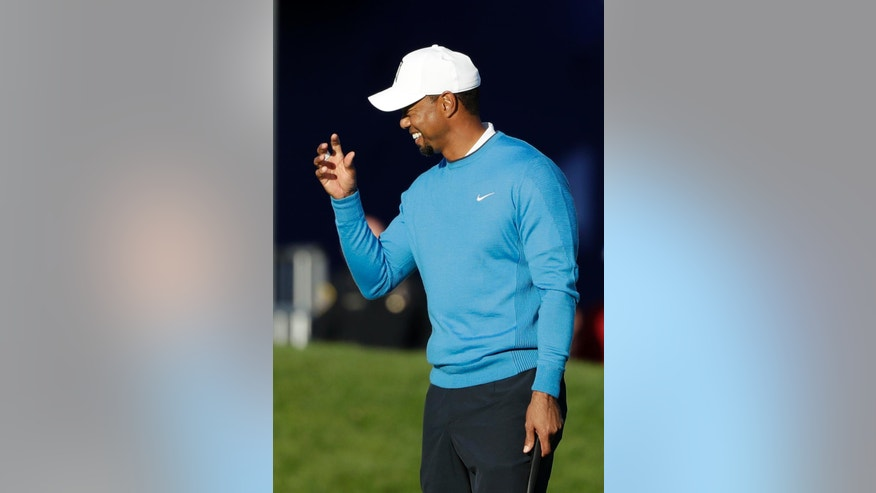 Tiger Woods reacts after finishing on the 18th hole of the south course during the first round of the Farmers Insurance Open golf tournament Thursday, Jan. 26, 2017, at Torrey Pines Golf Course in San Diego. (AP Photo/Gregory Bull)