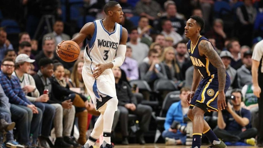 MINNEAPOLIS, MN - JANUARY 26: Kris Dunn #3 of the Minnesota Timberwolves handles the ball against Jeff Teague #44 of the Indiana Pacers during a game on January 26, 2017 at Target Center in Minneapolis, Minnesota. NOTE TO USER: User expressly acknowledges and agrees that, by downloading and/or using this photograph, user is consenting to the terms and conditions of the Getty Images License Agreement. Mandatory Copyright Notice: Copyright 2017 NBAE (Photo by Jordan Johnson/NBAE via Getty Images)