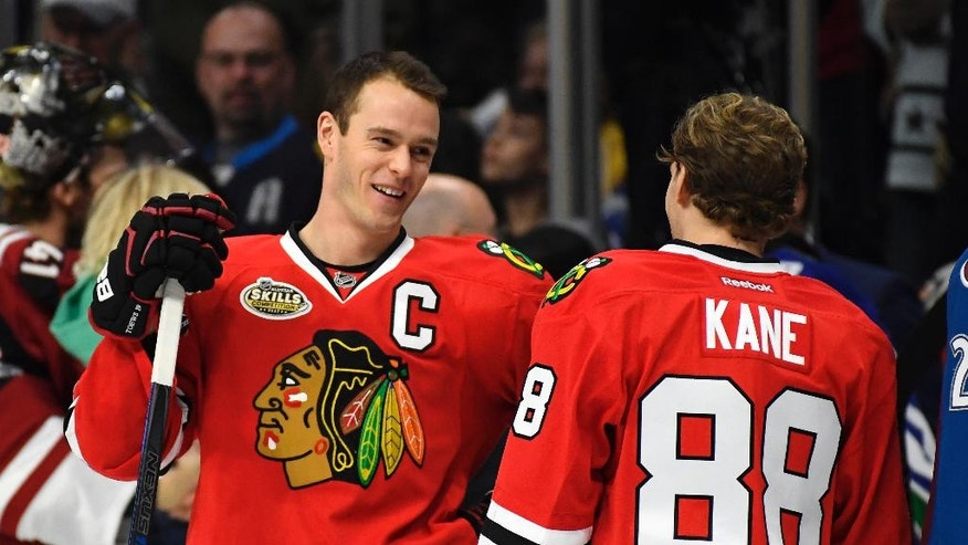 Chicago Blackhawks' Jonathan Toews, left, talk with teammate Patrick Kane during the NHL All-Star Skills Competition, Saturday, Jan. 28, 2017, in Los Angeles, the day before the All-Star Game. (AP Photo/Mark J. Terrill)
